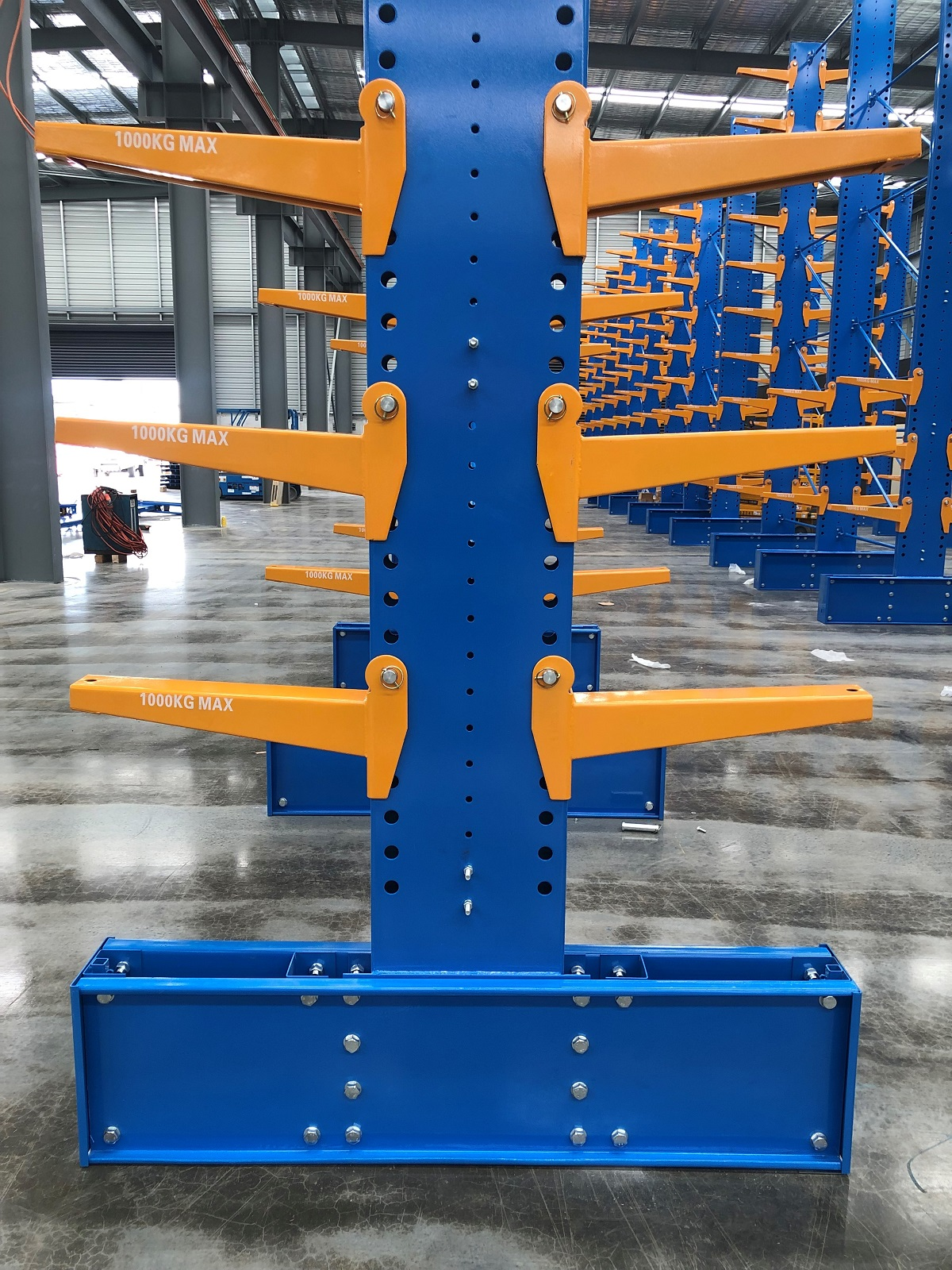 Blue and orange color storage racks placed on the big warehouse