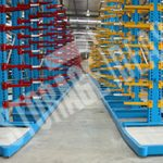 Multiple blue & yellow color stand racks and multiple blue & red color stand racks at the warehouse