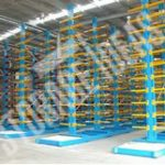 Long and heavy blue color stands with orange color racks